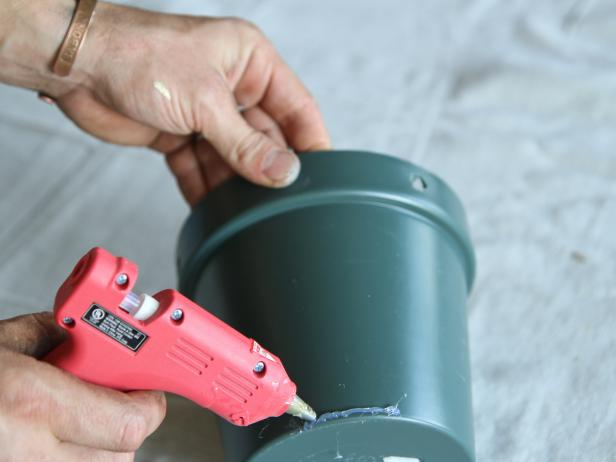 Apply hot glue to the bottom edge of the plastic pot.