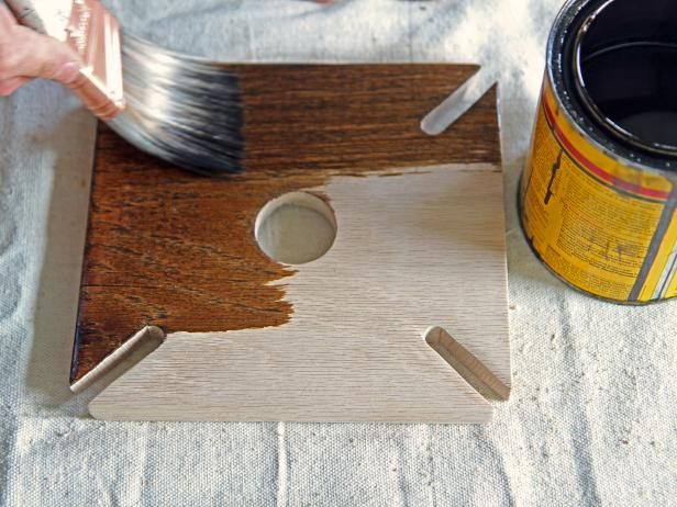 Stain the wood piece using a dark walnut stain.