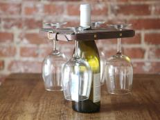 Add a rustic look to your decor by crafting a wine glass holder made with an old leather belt and a piece of oak wood.