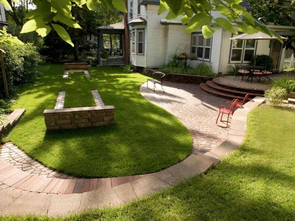 Backyard Paver Ideas pavers wouldnt take up my whole yard to do this but i like the idea of a paver patio adjacent to a pebble fire pit area 14 Fun Designs With Pavers 14 Photos