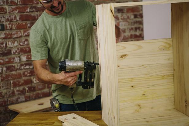 Attach cabinet backing using a nail gun.