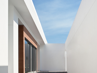 White Modern Courtyard With Black Stones