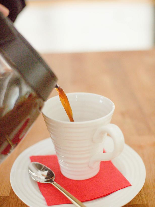 Add about ¼ tsp of maple syrup into the bottom of each cup, then top off with about a 1/2 cup of the warm spiced coffee mixture from the carafe. Spoon the foamed milk on top to fill each cup to about an inch below the rim.