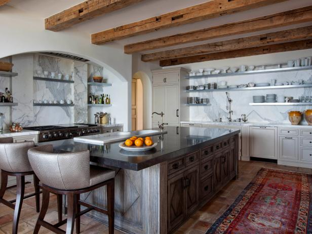Large Chef Kitchen with Marble Backsplash, Exposed Ceiling Beams and Large Custom Island