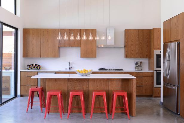 White Modern Kitchen With Red Barstools