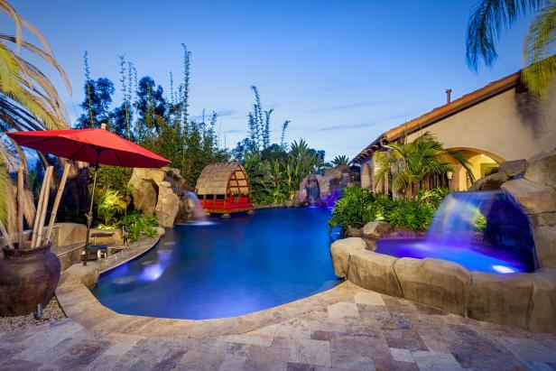 A Tropical Backyard Poolscape With Luxurious Features