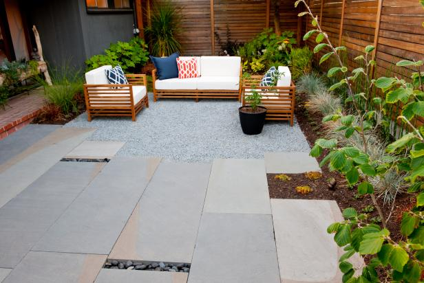 Modern Courtyard with Stone Pavers, Seating and Cedar Fencing