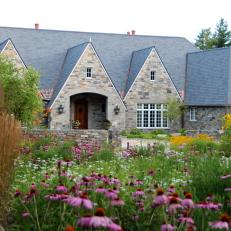 Old World-style Garden Design and Architecture with Stone Exterior and Perennials