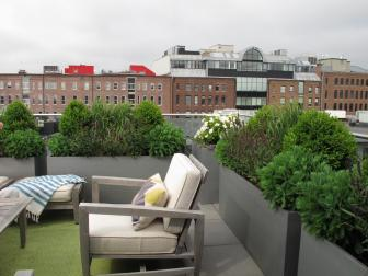 Modern Urban Rooftop with Outdoor Seating and Container Garden