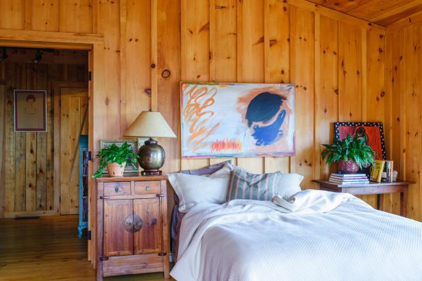 Folk Art as Headboard in Rustic Sleeping Cabin Bedroom