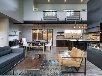 Industrial Style Great Room Features Softening Elements like Color, Fabrics