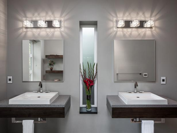Sleek, Modern Bathroom Features Dual Sinks and Shallow Floating Vanities
