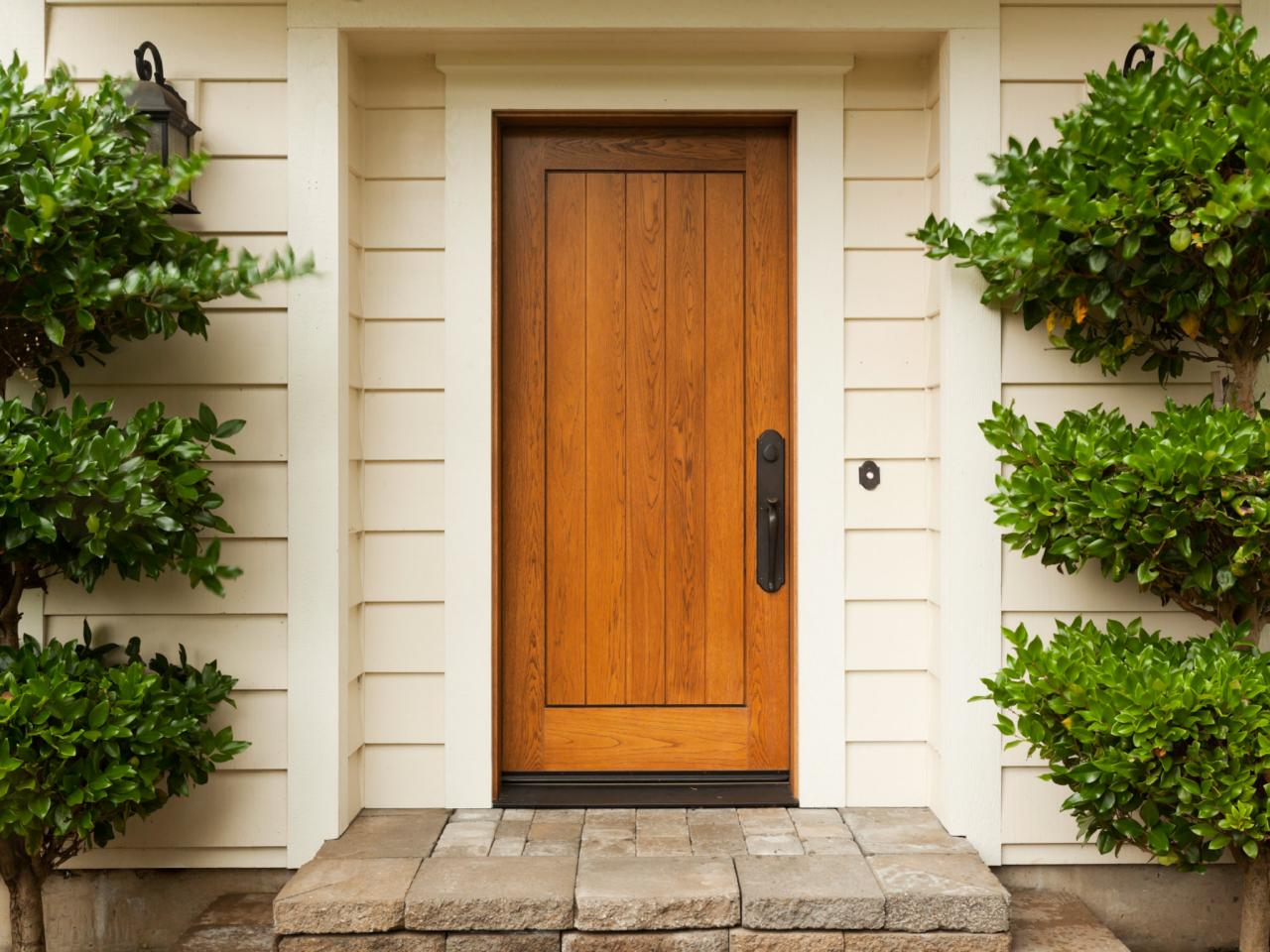 The pros and cons of a wood front door diy for Front entrance doors