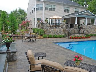 A Patio and Pool Design with Stone Veneer and Bluestone