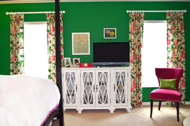 Bright Green Bedroom with Floral Curtains and a Detailed Media Cabinet