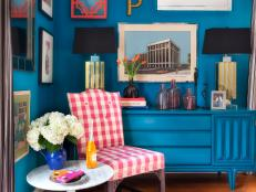 Sitting Area With Gingham Chair, Blue Wall, and Blue Dresser