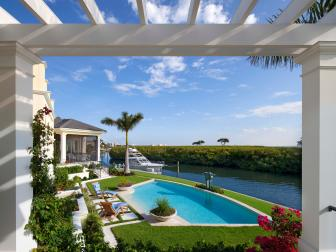 Pergola View of Dreamy Swimming Pool and Clean Landscaping of Waterfront Backyard