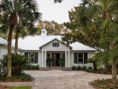 Crisp white shake siding with contrasting black trim gives this approximately 3,200-square-foot home in St. Simons Island, Georgia a strong presence and pleasing curb appeal.