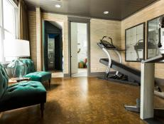 What once was a room with no real purpose was transformed into this user-friendly home gym with top-notch exercise equipment and an earthy color palette.