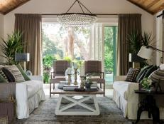 Soaring wood ceilings and walls of sliding glass doors define this central gathering space, where Southern style makes a sophisticated statement.
