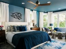 A star of HGTV Dream Home 2017, the grand master suite is a show-stopper with a chic navy bedroom, walk-in closet and spa-like bathroom.