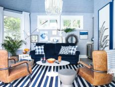 A chic lounge, wet bar, and bathroom bathed in blue hues create the perfect space for indoor and outdoor entertaining.