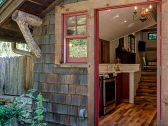 Rustic Cabin Exterior With Red Trim