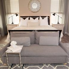 Gray Transitional Bedroom With Sunburst Mirror