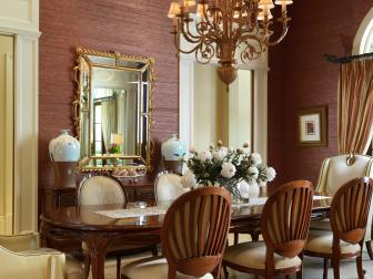 Rose Dining Room With Ornamental Traditional Chandelier and Sophisticated Decor