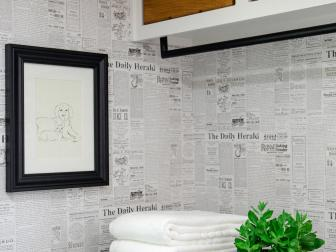 Renovated Laundry Room With Newspaper-Style Wallpaper and Crate Storage