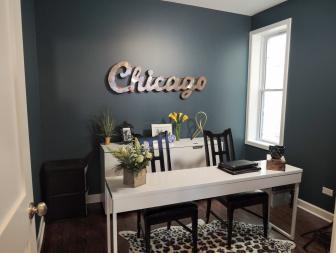 "Savvy Navy Home Office With Metal ""Chicago"" Sign, Thin White Desk and Leopard Print Rug"