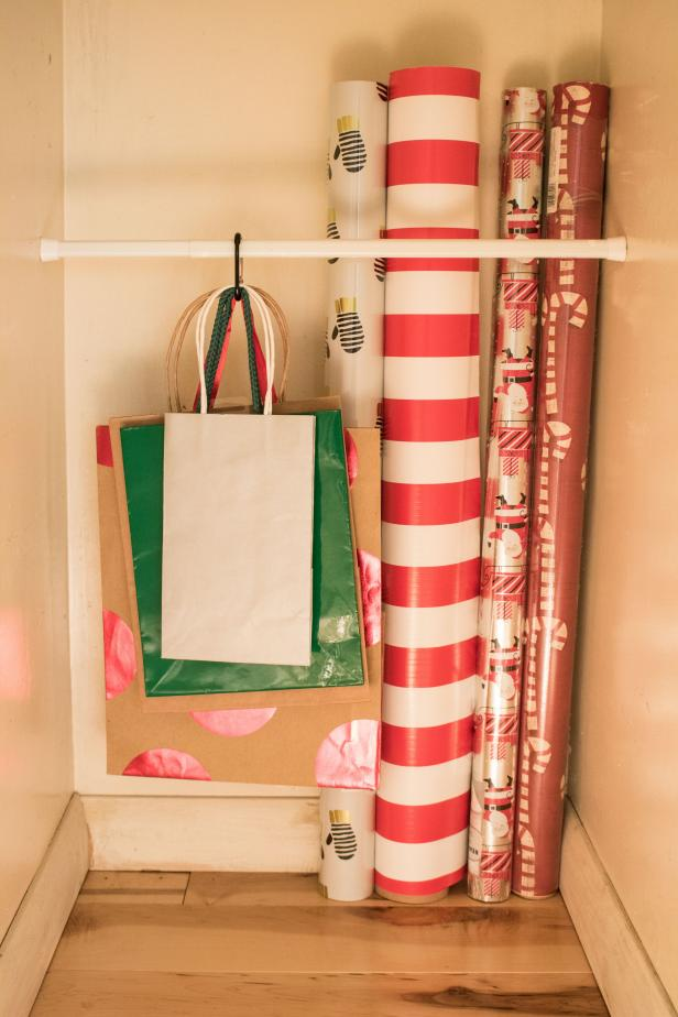 Using a Tension Rod to Organize Your Gift Wrapping Supplies