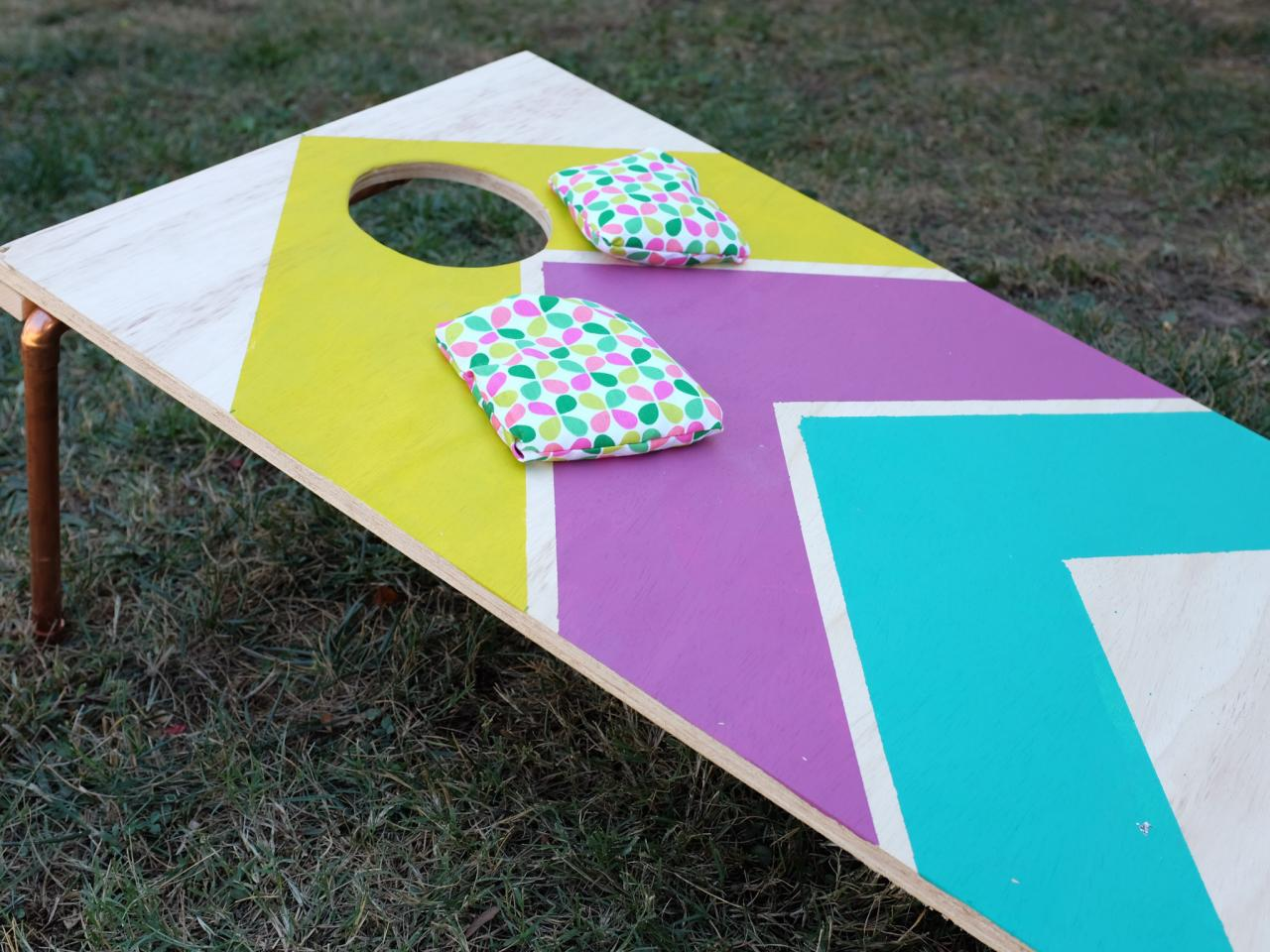 How to make designer cornhole boards hgtv 39 s decorating for Decoration hole