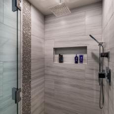 walkin shower with pebble tiles