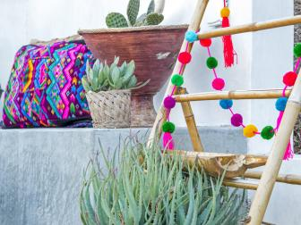 Colorful Pom Pom Garland Decorates Mexican-Inspired Patio