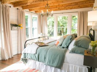 Renovated Bedroom With Exposed Wood Beams