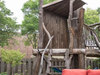 Backyard Deck With Rustic Kids' Treehouse