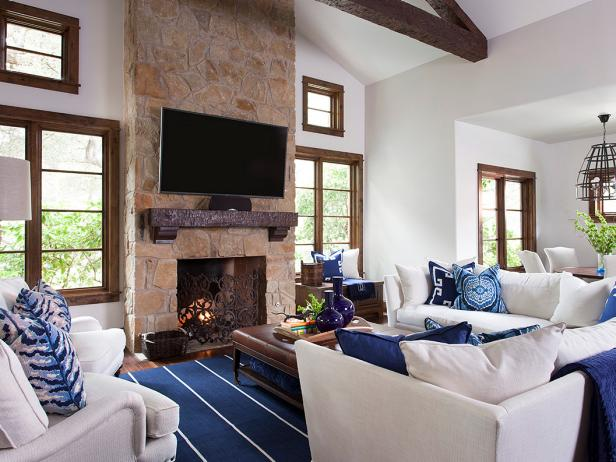 White Great Room Features Dark Wood Trim, Stylish Blue Accents