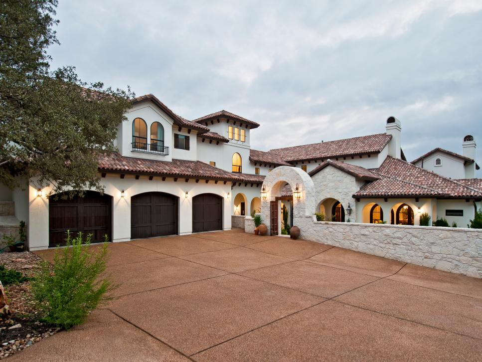 Spanish style austin home with arched stone gate jenkins for Austin house