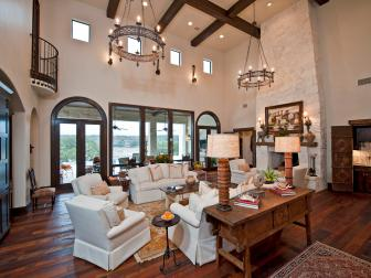 Rustic Living Room with Beamed Ceiling, Stone Fireplace
