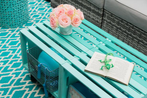 Vibrant color, plentiful storage and casual style make this DIY outdoor coffee table perfect for almost any decor.