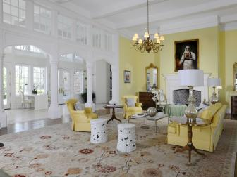 Classic Yellow Sitting Room With Arched Doorways