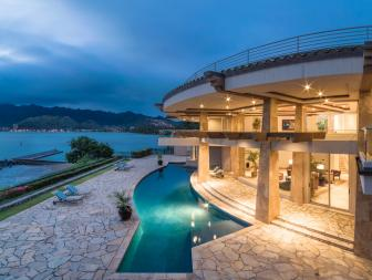 Contemporary Circular Waterfront House With Pool