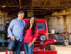 Chip and Joanna Gaines in Front of Magnolia Market