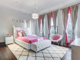 Transitional Pink and White Girl's Bedroom With Tufted Bed Frame