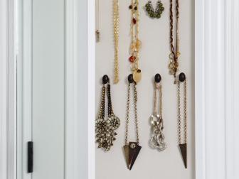 Jewelry Hanging on Wall Rack in Walk-In Closet
