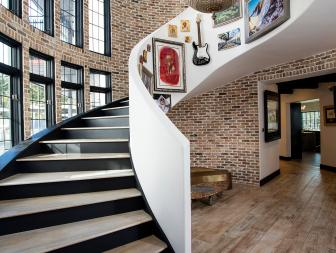 Brick Foyer With Curved Staircase