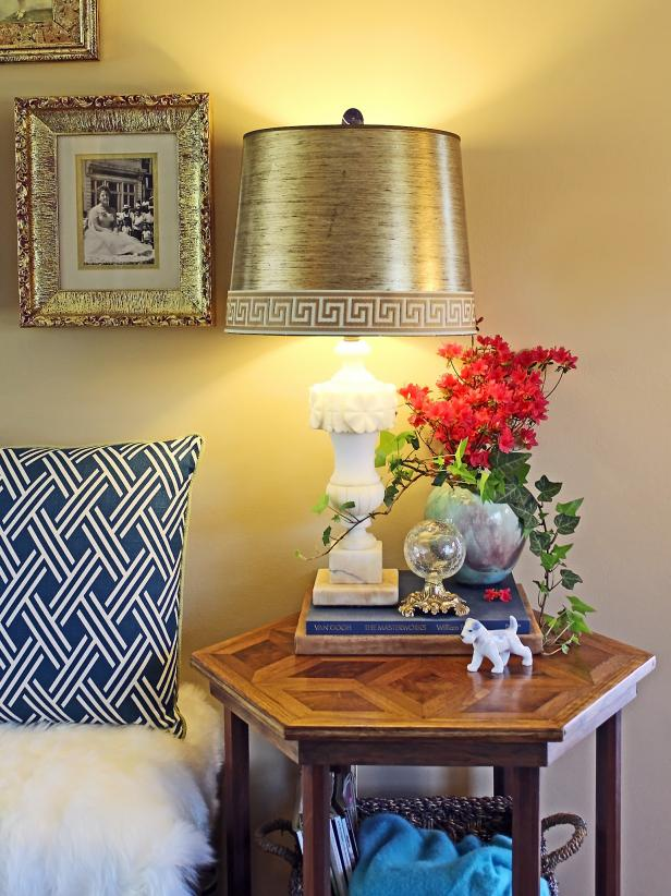 Turn an old trashed drum-style lampshade into a trendy treasure by simply adding Greek key upholstery tape trim.