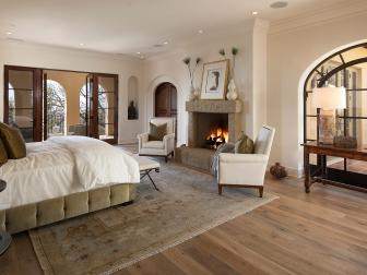 Neutral Eclectic Bedroom With Stone Fireplace