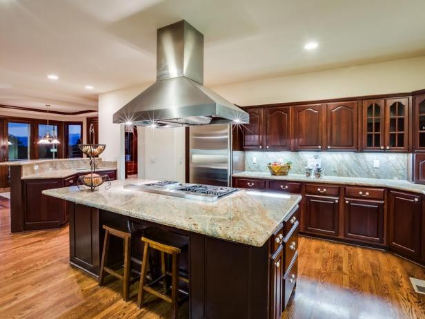 Brown Traditional Chef's Kitchen With Range Hood